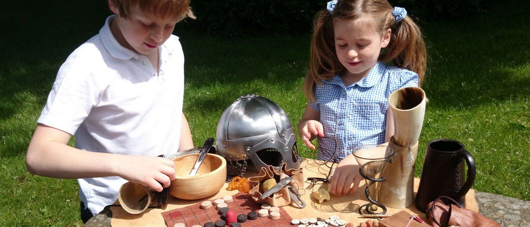 Children playing with Viking tools