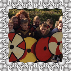 Children using Viking shields