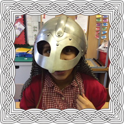 School girl wearing Viking helmet